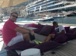 Paul Adamson with Eddie Jordan onboard LUSH, with Monaco Yachtclub in the backround